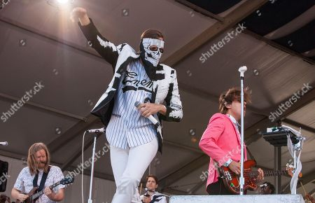 Tim Kingsbury, Win Butler and William Butler of Arcade Fire performs at the New Orleans Jazz and Heritage Festival in New Orleans on