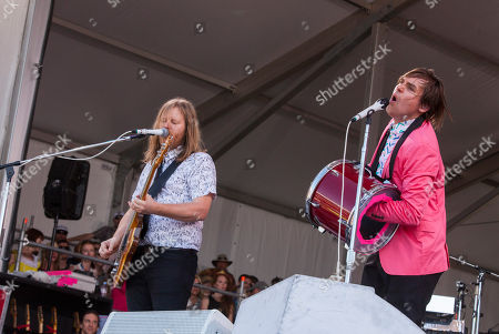 Tim Kingsbury and William Butler of Arcade Fire perform at the New Orleans Jazz and Heritage Festival in New Orleans on