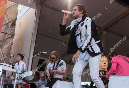 Regina Chassagne, Tim Kingsbury, Win Butler and William Butler of Arcade Fire performs at the New Orleans Jazz and Heritage Festival in New Orleans on