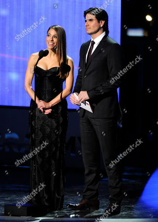 Stock Photo of Debi Nova, left, and Daniel Arenas present the award for record of the year at the 15th annual Latin Grammy Awards at the MGM Grand Garden Arena, in Las Vegas
