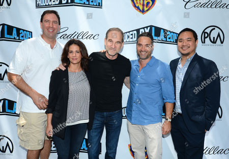 From left, Peter Micelli, Jessika Borsiczky, Marshall Herskovitz, Morgan Wandell, and Quan Phung arrive at the 2014 Produced By Conference - Day 1 at Warner Bros. Studios, in Burbank, Calif