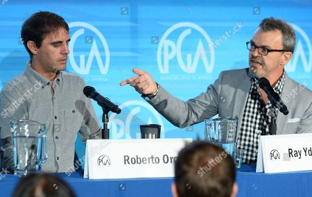 Roberto Orci, left, and Ray Ydoyaga speak on stage at the Produced By Conference - Day 2 at Warner Bros. Studios, in Burbank, Calif
