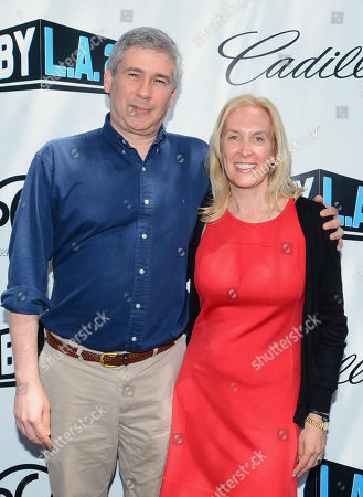 Christopher Keyser, president of the Writers Guild of America, left, and Susan Sprung, associate national executive director of the Producers Guild of America attend the Produced By Conference - Day 2 at Warner Bros. Studios, in Burbank, Calif