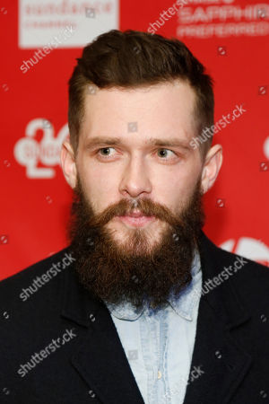 """Cast member Grigoriy Dobrygin poses at the premiere of the film """"A Most Wanted Man"""" during the 2014 Sundance Film Festival, on in Park City, Utah"""