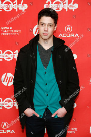 """Cast member Eric Tabach poses at the premiere of the film """"Love is Strange"""" during the 2014 Sundance Film Festival, on in Park City, Utah"""
