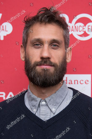 """Composer Rob Simonsen poses at the premiere of the film """"Wish I Was Here"""" during the 2014 Sundance Film Festival, on in Park City, Utah"""
