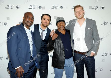 """Retired professional boxers Evander Holyfield, left, and Mike Tyson pose with director Bert Marcus and producer Grant Jolly, right, at the """"Champs"""" Tribeca Talks after screening event, during the 2014 Tribeca Film Festival, at the SVA Theatre on in New York"""