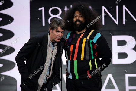 Recording artist Stephen Malkmus, left, and comedian Reggie Watts, right, appear onstage at the 2014 Webby Awards, in New York