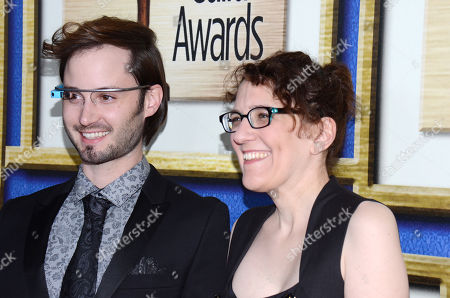 Brad Bell, left, and Jane Espenson arrive at the Writers Guild Awards,, in Los Angeles