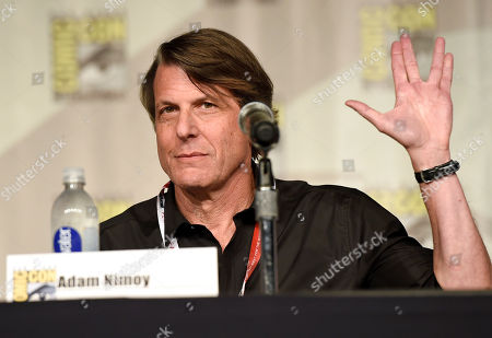 """Adam Nimoy gives the Vulcan salute at the """"NASA: Turning Science Fiction into Science Fact"""" panel on day 1 of Comic-Con International, in San Diego, Calif"""