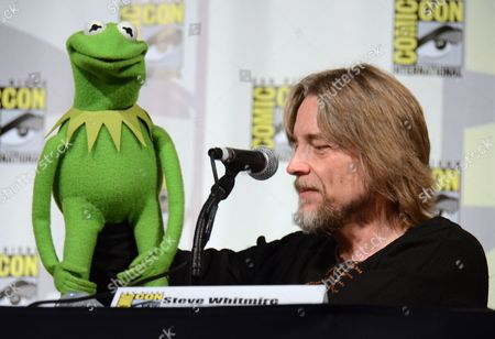 "Stock Photo of Kermit the Frog, left, and puppeteer Steve Whitmire attend ""The Muppets"" panel on day 3 of Comic-Con International, in San Diego"