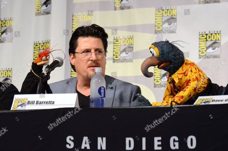 "Pepe the King Prawn, left, puppeteer Bill Barretta, and The Great Gonzo, attend ""The Muppets"" panel on day 3 of Comic-Con International, in San Diego"