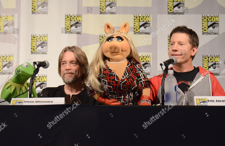 "Stock Picture of Kermit the Frog, left, puppeteer Steve Whitmire, Miss Piggy, and puppeteer Eric Jacobson attend ""The Muppets"" panel on day 3 of Comic-Con International, in San Diego"