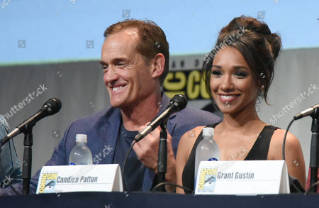 "John Wesley Shipp, left, and Candice Patton attend the ""The Flash"" panel on day 3 of Comic-Con International, in San Diego"