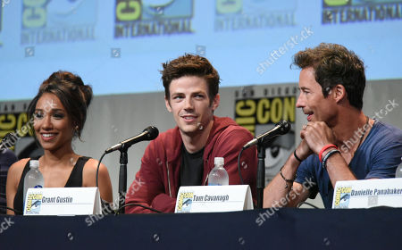 "Candice Patton, from left, Grant Gustin and Tom Cavanagh attend the ""The Flash"" panel on day 3 of Comic-Con International, in San Diego"