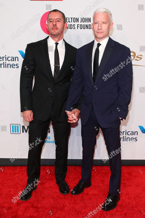 "Stock Picture of Benjamin Maisani, left, and Anderson Cooper, right, attend the Elton John AIDS Foundation's 14th Annual ""An Enduring Vision"" Benefit at Cipriani Wall Street, in New York"