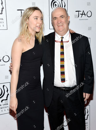 Actress Saoirse Ronan, left, and author Colm Toibin attend the New York Film Critics Circle Awards at TAO Downtown, in New York