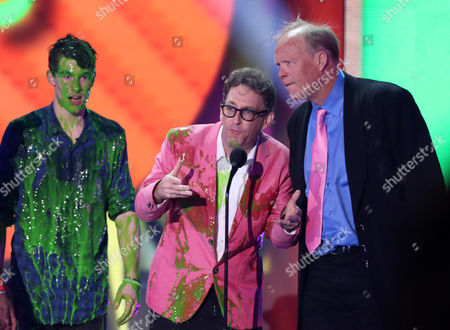 Stock Photo of Shawn Mendes, left, presents Tom Kenny and Bill Fagerbakke with the award for favorite cartoon for SpongeBob SquarePants at Nickelodeon's 28th annual Kids' Choice Awards at The Forum, in Inglewood, Calif
