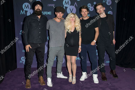 Mike Tayler, Gianni Luminati, Sarah Blackwood, Ryan Marshall and Joel Cassady of Walk Off The Earth pose in the press room at the Much Music Video Awards, in Toronto, Canada