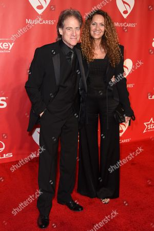 Richard Lewis, left, and Joyce Lapinsky arrive at the 2015 MusiCares Person of the Year event at the Los Angeles Convention Center on in Los Angeles