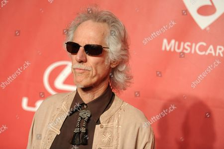 John Densmore arrives at the 2015 MusiCares Person of the Year event at the Los Angeles Convention Center, in Los Angeles