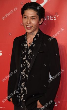 Takamasa Ishihara arrives at the 2015 MusiCares Person of the Year event at the Los Angeles Convention Center on in Los Angeles