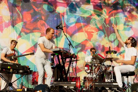 In center on keyboards, Dan Snaith performs with band members of Caribou at the 2015 Pitchfork Music Festival, on in Chicago