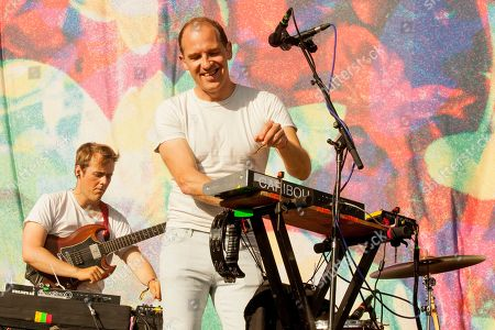 On right playing keyboards, Dan Snaith performs with band members of Caribou at the 2015 Pitchfork Music Festival, on in Chicago