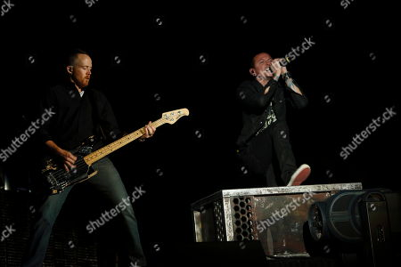 Dave Farrell (left), Chester Bennington and Linkin Park perform at Rock in Rio USA at the MGM Resorts Festival Grounds, in Las Vegas, Nevada