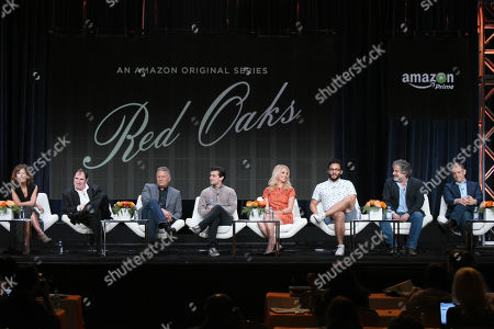 "Jennifer Grey, from left, Richard Kind, Paul Reiser, Craig Roberts, Gage Golightly, Ennis Esmer and writer/producers Gregory Jacobs and Joe Gangemi participate in the ""Red Oaks"" panel at the Amazon Summer TCA Tour at the Beverly Hilton Hotel, in Beverly Hills, Calif"