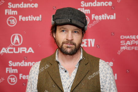 """Actor Tim Guinee poses at the premiere of """"99 Homes"""" during the 2015 Sundance Film Festival, in Park City, Utah"""