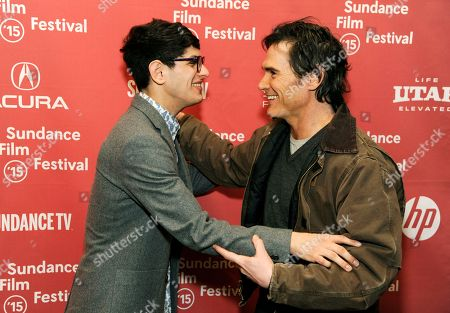 """Matt Bennett, left, and Billy Crudup, cast members in """"Stanford Prison Experiment,"""" greet each other at the premiere of the film at the Eccles Theatre during the 2015 Sundance Film Festival, in Park City, Utah"""