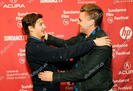 """Tye Sheridan, left, and Brett Davern, cast members in """"Stanford Prison Experiment,"""" greet each other at the premiere of the film at the Eccles Theatre during the 2015 Sundance Film Festival, in Park City, Utah"""
