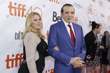 """Chazz Palminteri, right, and Gianna Ranaudo attend the world premiere of """"Legend"""" on day 3 of the Toronto International Film Festival at Roy Thomson Hall, in Toronto"""