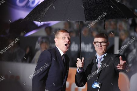 """Stock Photo of Brian Helgeland, left, attends the International Premiere for """"Legend"""" on day 3 of the Toronto International Film Festival at Roy Thomson Hall, in Toronto"""