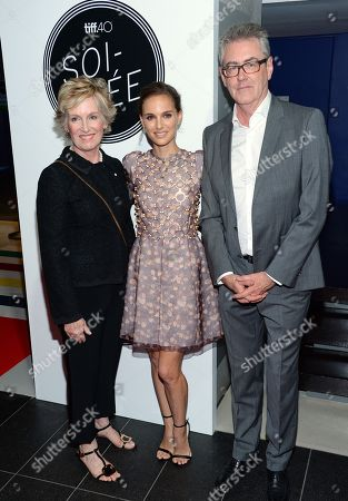 TIFF chair, Lisa de Wilde, from left, actress Natalie Portman and TIFF director and CEO, Piers Handling, attend the TIFF Soiree: On-Stage Conversation with Natalie Portman charity event during the 2015 Toronto International Film Festival, in Toronto