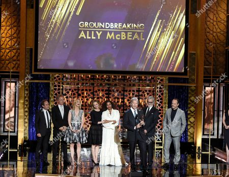 """David E. Kelley and the cast of """"Ally McBeal"""" accept the groundbreaking award at the TV Land Awards at the Saban Theatre, in Beverly Hills, Calif. Looking on from left are Peter MacNicol, Greg Germann, Courtney Thorne-Smith, Calista Flockhart, Lisa Nicole Carson, Bill D'Elia and Gil Bellows"""