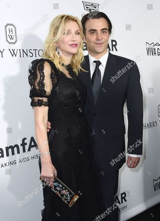 Courtney Love, left, and Nicholas Jarecki arrive at the amfAR Inspiration Gala Los Angeles at Milk Studios on