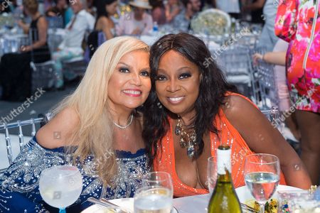 Suzanne de Passe, left, and Star Jones attend the 2016 Art For Life Benefit, presented by Russell Simmons' RUSH Philanthropic Arts Foundation, at Fairview Farms,, in Water Mill, New York