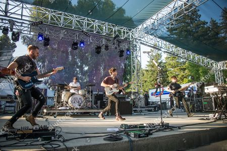 Matt Fazzi, left, Michael Jeffery, Keith Jeffery, and Kevin McPherson of Atlas Genius perform at BottleRock Napa Valley Music Festival at Napa Valley Expo, in Napa, Calif