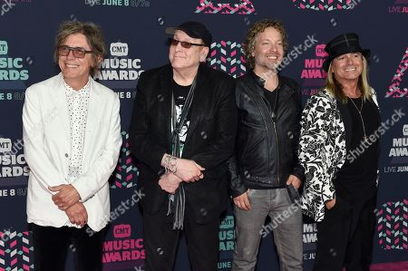 Tom Petersson, from left, Rick Nielsen, Daxx Nielsen and Robin Zander, of Cheap Trick, arrive at the CMT Music Awards at the Bridgestone Arena, in Nashville, Tenn