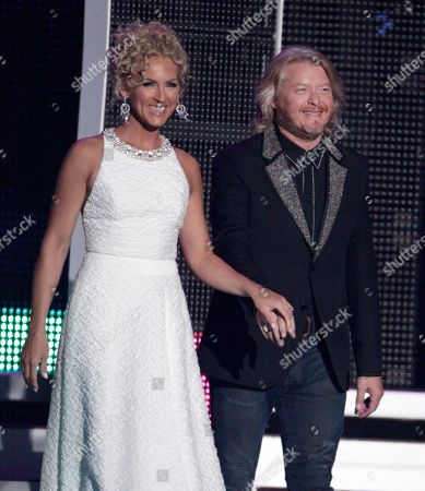 Kimberly Roads Schlapman, and Phillip Sweet appear on stage to present the award for breakthrough video of the year at the CMT Music Awards at the Bridgestone Arena, in Nashville, Tenn