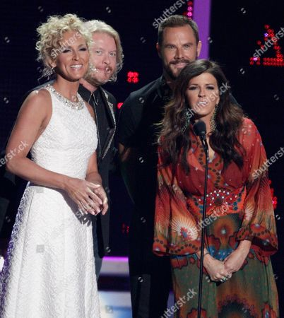 Stock Image of Little Big Town presents the award for breakthrough video of the year at the CMT Music Awards at the Bridgestone Arena, in Nashville, Tenn. From left are, Kimberly Roads Schlapman, Phillip Sweet, Jimi Westbrook and Karen Fairchild