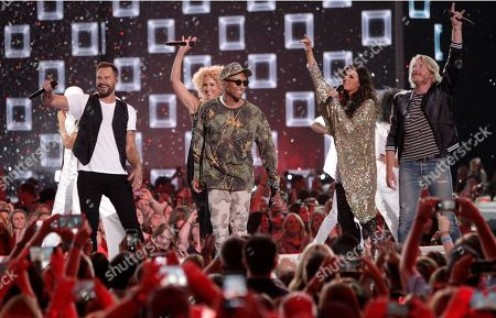 Stock Picture of Pharrell Williams, second from left, and Little Big Town perform One Dance at the CMT Music Awards at the Bridgestone Arena, in Nashville, Tenn. From left are, Jimi Westbrook, Kimberly Roads Schlapman, Pharrell Williams, Karen Fairchild and Phillip Sweet