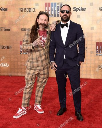 Oliver Peck, left, and Chris Nunez arrive at the Guys Choice Awards at Sony Pictures Studios, in Culver City, Calif