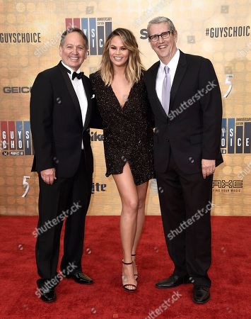 Spike TV President Kevin Kay, from left, Chrissy Teigen, and Viacom Music & Entertainment Group President Doug Herzog arrive at the Guys Choice Awards at Sony Pictures Studios, in Culver City, Calif