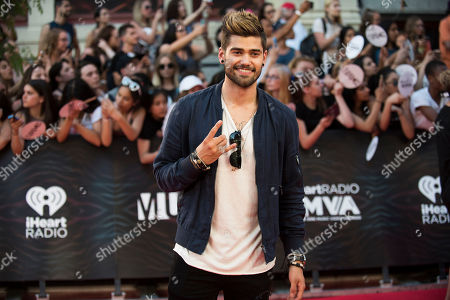 Rajiv Dhall arrives at the 2016 iHeartRadio MuchMusic Video Awards, in Toronto, Canada