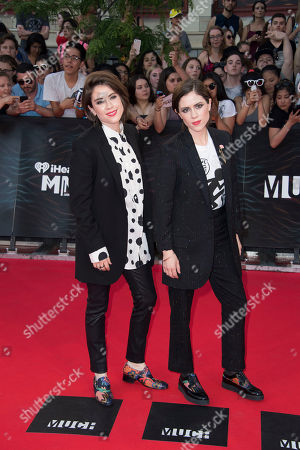 Tegan Rain Quin and Sara Keirsten Quin of Tegan and Sara arrive at the 2016 iHeartRadio MuchMusic Video Awards, in Toronto, Canada