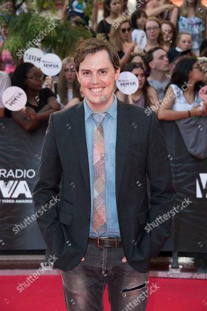Josh Vokey arrives at the 2016 iHeartRadio MuchMusic Video Awards, in Toronto, Canada