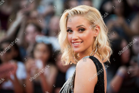 Liz Trinnear arrives at the 2016 iHeartRadio MuchMusic Video Awards, in Toronto, Canada